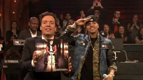 J-Cole-Black-Apple-Broadway-Denim-Jacket-with-Leahter-Sleeves-on-Late-Night-with-Jimmy-Fallon-